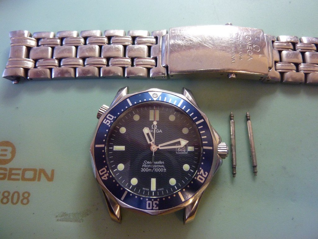 The new Omega sapphire glass is fitted - now the service can proceed.