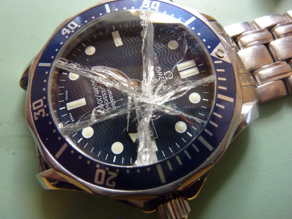 Omega with smashed glass. The glass fragments have penetrated the watch so it needs a full service and new glass.