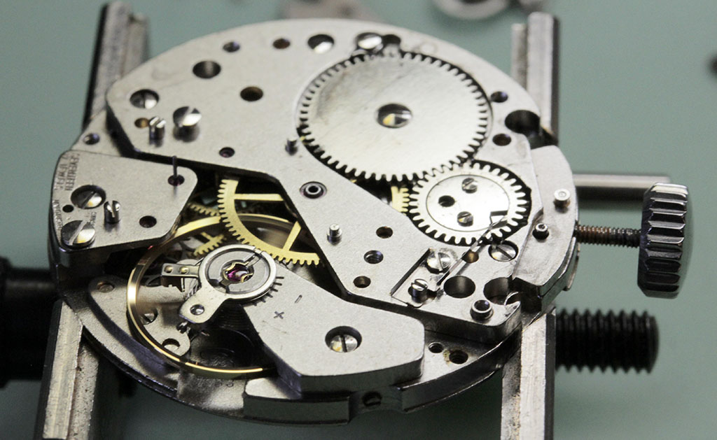 Testing the watch is working before chronograph re-assembly